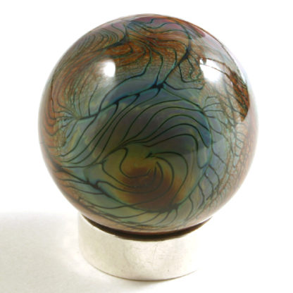 glass marble with sqiggly black lines