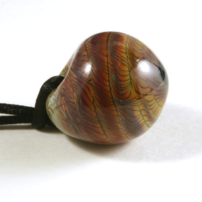 brown glass penqdant with black squiggly lines