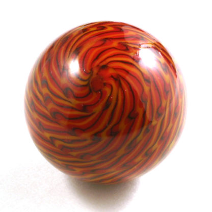 red glass marble with yellow and black lines