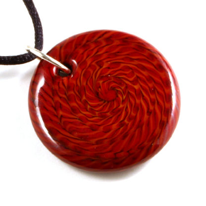 red glass round pendant with black lines